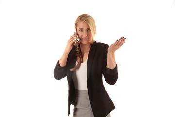 Frau im Business Outift telefoniert mobil