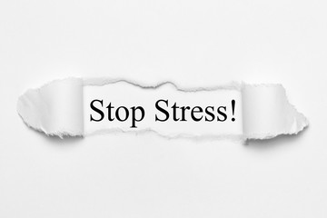 Stop Stress! on white torn paper
