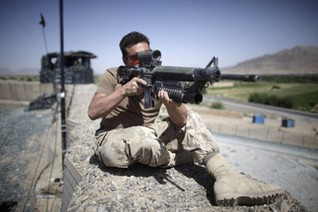 A canadian soldier takes position at an observation point during a patrol at in Kandahar Province