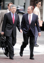 Former Enron CEO Skilling talks to his attorney on the way to Houston Federal Courthouse for a pre-trial hearing