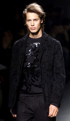 A MODEL WEARS AN OUTFIT AS PART OF BYBLOS AUTUMN/WINTER MEN'S COLLECTION IN MILAN.