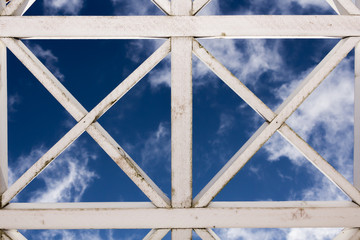 vintage painted white wooden lattice, sky on the background