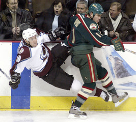 WILD WINGER DUPUIS UPENDS AVALANCHE WING AUBIN IN DENVER.