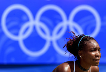 Venus Williams of the USA awaits serve from [Tamarine Tanasugarn of Thailand] during their Olympic m..