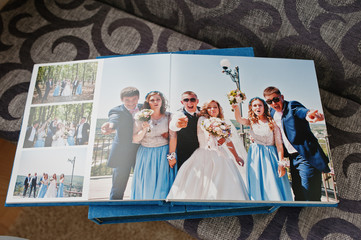 Open pages of wedding photo book and album