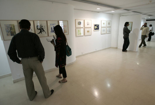 """People attend the """"Lines of Control"""" exhibition in Karachi"""