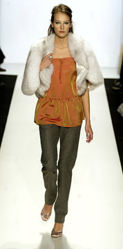 A model for Jeffrey Chow wears a natural fox capelet with iridescent sherbet silk drop waist tank an..