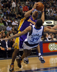 Lakers Fisher knocks over Mavericks Harris on his way to the basket in third quarter NBA basketball action in Dallas