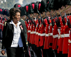 Canadian Governor General Jean inspects the honour guard after being sworn-in in Ottawa