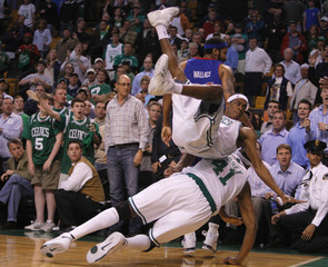 Boston Celtics' Rondo falls on teammate Posey as the Pistons try to inbound the ball during their NBA Eastern Conference Final basketball playoff series in Boston