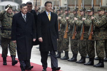 Macedonia's President Branko Crvenkovski walks past Bosnian army honour guards upon his arrival in Sarajevo