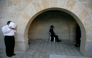 Ultra Orthodox Jewish men attend a mass prayer at the Western Wall in the Old City of Jerusalem