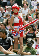Fan dressed as a nurse dances during Rugby World Cup Sevens in Hong Kong.