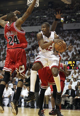 Miami Heat forward Posey drives against Chicago Bulls forward Thomas during the first half of game three in the first round of NBA playoff action in Miami