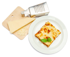 Portion of tasty lasagna isolated on white