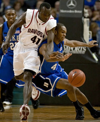 Davidson's Andrew Lovedale (41) battles for the ball against Duke's Lance Thomas (R) during the first half of their NCAA basketball game at Charlotte Bobcats Arena in Charlotte