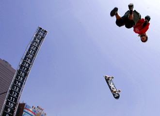Seventeen-year-old Lorifice loses his skateboard as he flies out of quarterpipe at 11th annual X Games ...