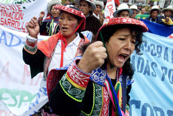 Andean women take part in a march against mining companies that they say contaminate their lands, in..