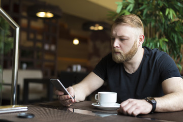 Successful intelligent business man relaxing in a luxury restaurant outdoors, confident thoughtful entrepreneur, wealthy men pensive rest and waiting someone in the modern coffee shop terrace