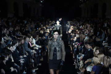 Models present creations by Italian fashion designer Armani during a fashion show at the GUM department store in Moscow