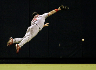 St. Louis Cardinals dives but is unable to reach a double by Los Angeles Dodgers Jeff Kent in Los Angeles.