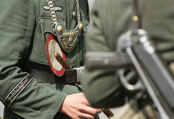 Actors dressed as Nazi soldiers stand in front of the German Finance Ministry, formerly Air Force Ministry, in Berlin