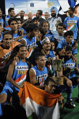 India's junior hockey team players celebrate their win over South Korea in the final match of the Sixth Men's Junior Asia Cup hockey tournament in Hyderabad