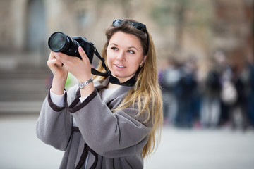Young woman looking curious and taking pictures