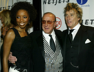 CLIVE DAVIS AND ROD STEWART AT J RECORDS PRE GRAMMY PARTY.