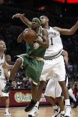 Celtics Rondo gets past Spurs Duncan during the second half of their NBA basketball game in San Antonio