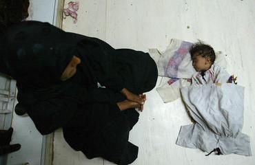 IRAQI WOMAN WATCHES HER DAUGHTER AT THE WOMEN AND CHILDRENS HOSPITAL INNASSIRIYA.