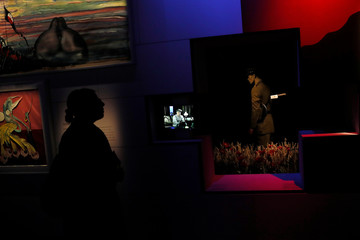 A woman is silhouetted at The Pink Floyd Exhibition: Their Mortal Remains at the V&A Museum in London