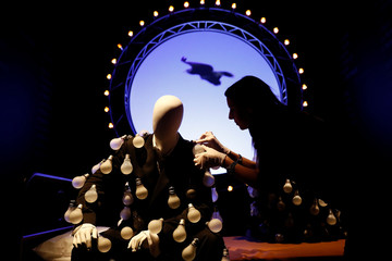 An assistant poses for a photograph at The Pink Floyd Exhibition: Their Mortal Remains at the V&A Museum in London