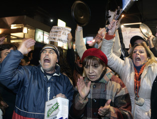 Demonstrators shout anti-government slogans in street in Buenos Aires