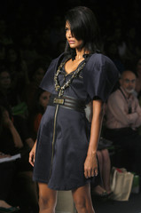A model displays an outfit designed by Falguni and Peacock during a fashion show on the first day of India Fashion Week in New Delhi
