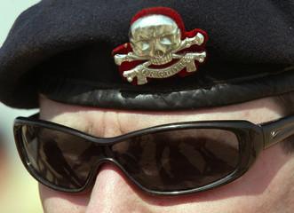 BRITISH ARMY SERGEANT WEARS SKULL AND CROSSBONES BADGE IN KUWAITDESERT.