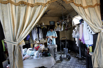 Hurricane Katrina holdout stands inside his home in the ninth ward of New Orleans.