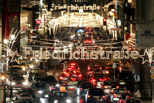 Traffic streams down of one of Berlin's main shopping road Friedrichsstrasse illuminated by Christma..