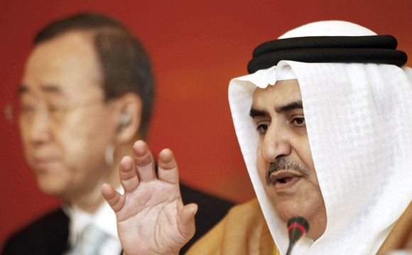 Bahrain's Foreign Minister Sheikh Khalid bin Ahmed Al Khalifa speaks as United Nations Secretary-General Ban looks on at a briefing after the UN Conference in Manama