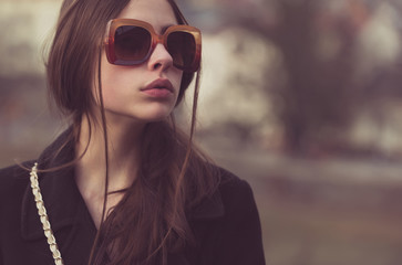 Pretty girl in fashionable, vintage sunglasses