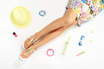Women legs and summer fashion stylish accessories top view