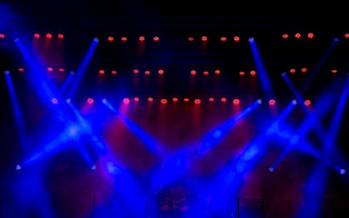 Stage light with colored spotlights and smoke.