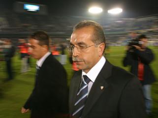 Malaga's new coach Antonio Tapia walks before start of first division match against Sevilla in Malaga.