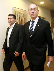 Israel's PM Olmert and Defence Minister Amir Peretz arrive for the weekly cabinet meeting in Jerusalem