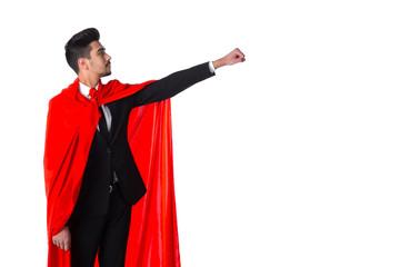 Businessman in superhero red cloak raises hand up