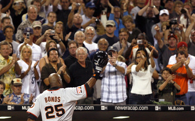 San Francisco Giants' Barry Bonds waves to fans as he leaves the game after hitting his 755th career home run during their MLB National League baseball game against the San Diego Padres in San Diego