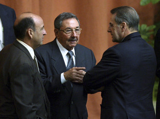 Carlos Lage, Raul Castro and Jacques Rogge talk during the inauguration of the International Sport for All Congress in Havana