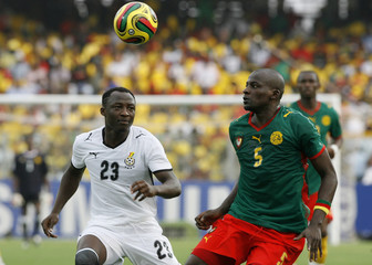 Ghana's Dramani challenges Cameroon's Atouba during their semi-final match at the African Nations Cup soccer tournament in Accra