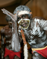 A performer with the Yalakun Dance Group from north east Arhnem Land  open an Aboriginal art exhibit..