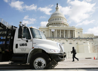 A truck delivering construction material for the inaugural platform has a wheel stuck in a drainage at U.S. Capitol in Washington